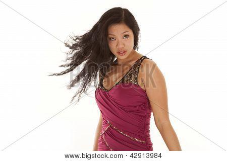 Asian Woman Flip Hair Serious