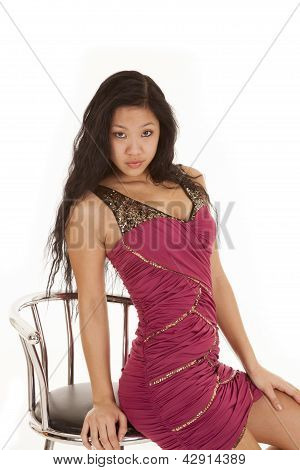 Asian Woman Red Ddress Edge Of Stool