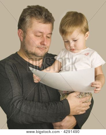Father With Son Are Looking The Picture