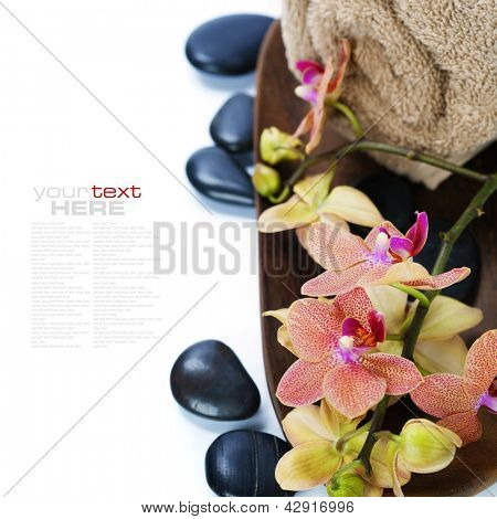 spa concept (zen stones,  orchid flower and towel) over white  (with easy removable sample text)