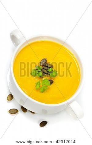 Traditional Pumpkin soup in white bowl  with ingredients