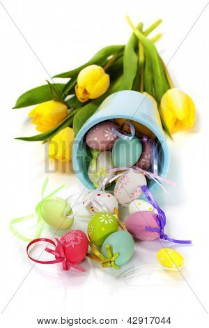 easter composition with fresh tulips and easter eggs over white