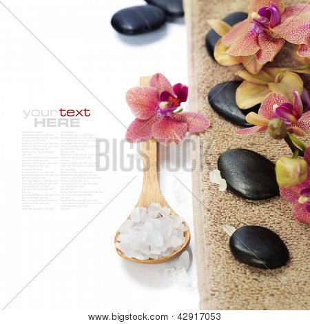 spa concept (zen stones, sea salt, orchid flower and towel) over white  (with easy removable sample text)
