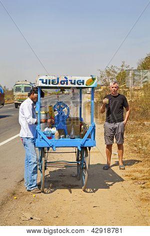 Street Vendor Serving Caucasion Pursing Lips