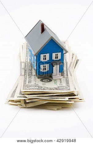 Model House On Dollar Bills Isolated On White Background