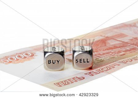 Two Metal Dices With Words Buy And Sell On Five Thousand Rouble Banknote Isolated On White Backgroun
