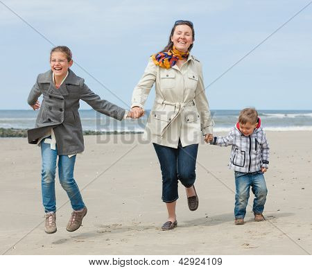 Mother and her kids at the beach