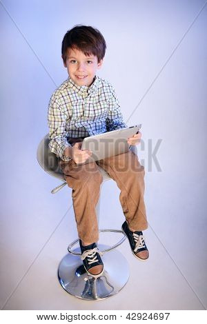 Happy little boy with a tablet pc
