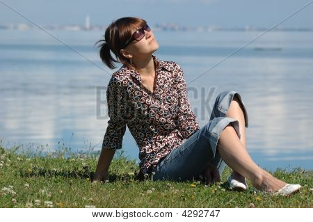 Sunbathing Girl On The Grass