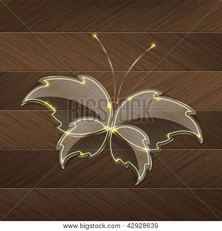 Leaf Glass Butterfly With A Yellow Neon Light Over A Wood Background