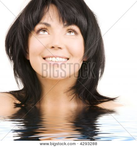 Happy Woman Looking Up In Water