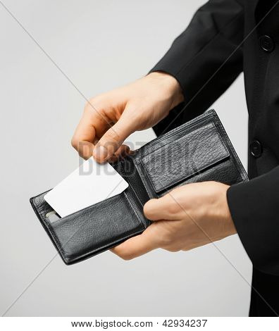 man in suit with wallet and credit card.