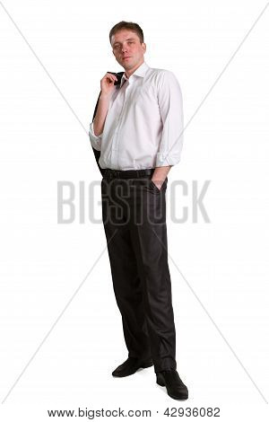 Businessman With Jacket On Shoulder And Hand In Pocket Posing And Smiling