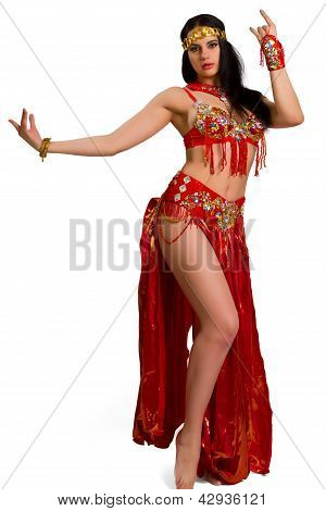 Girl In A Red Suit Oriental Dance In Motion Isolated On White