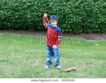 Boy Practicing Baseball