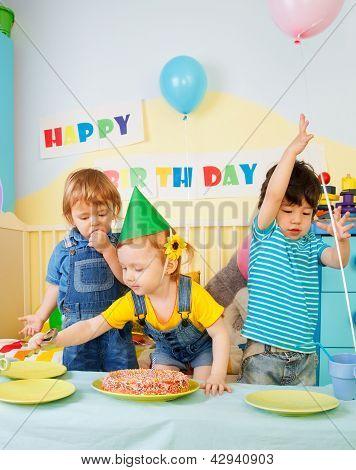 Three Kids Having Fun On The Birthday Party