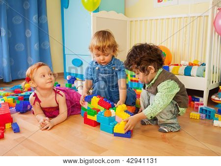 Kids Playing With Plastic Blocks