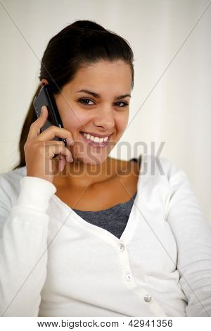 Young Woman Speaking On Cellphone Looking At You