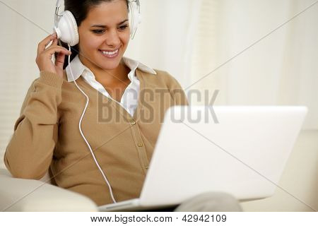 Chaming Young Woman With Headphone Listening Music