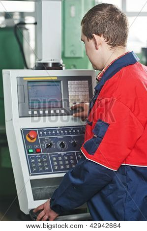 technician engineer worker near cnc milling machine center at tool manufacturing