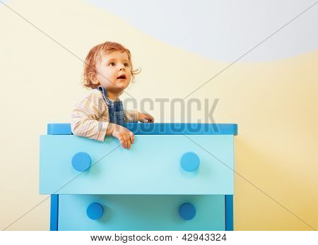 Toddler Sitting In The Box