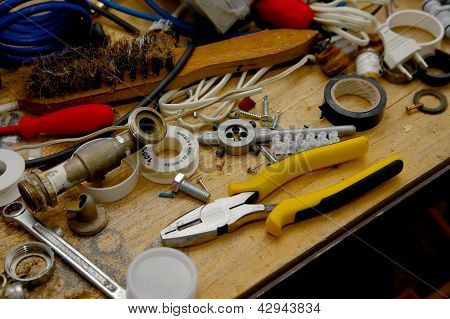 Tools on a messy workshop table