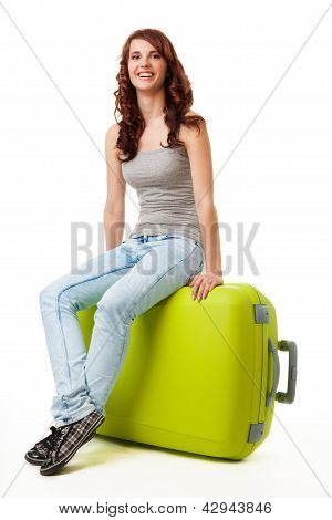 Happy Nice Girl Sitting On The Big Green Bag