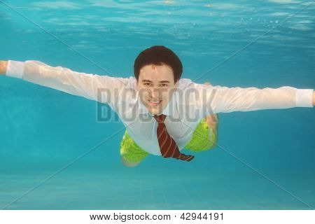 Business Man Swimming Underwater In The Pool