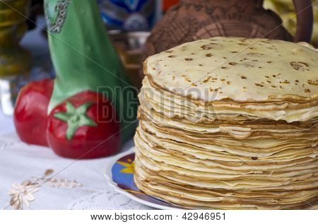 Shrovetide Pancakes On A Festive Table