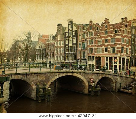 Retro image of Prinsengracht Canal, Amsterdam, The Netherlands.   Paper texture.