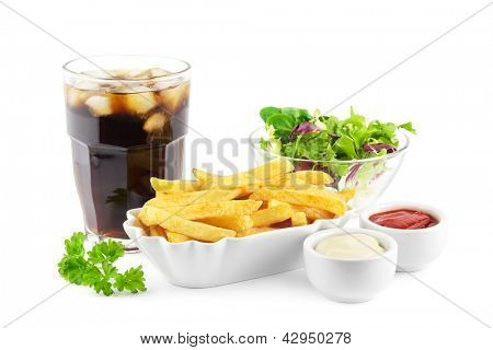 French fries with soda and a fresh lettuce salad