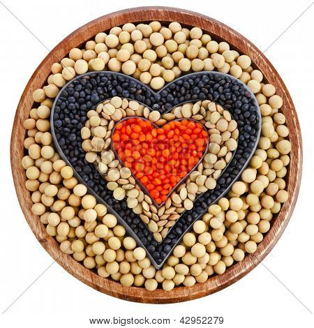 soybean and a variation of lentils in a wooden bowl isolated on white background