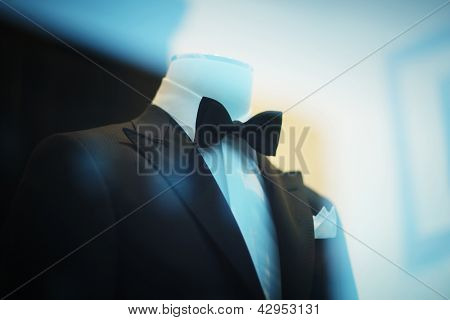 Black tuxedo suit on display.