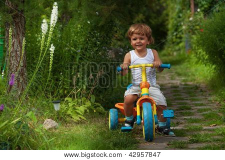 Little Boy Riding Tricycle