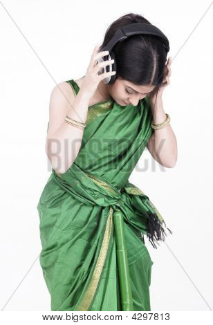 Woman Of Indian Origin Wearing A Headphone And Listening To Music