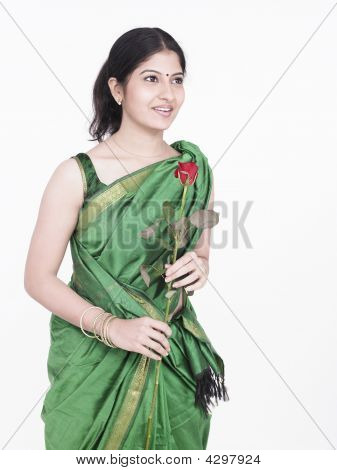 Woman Of Indian Origin Holding A Single Rose