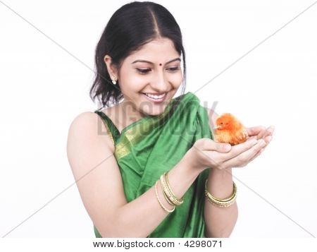 Woman Of Indian Origin With A Orange Coloured Chick
