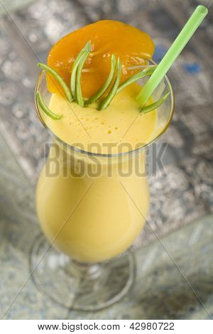 Indian, cocktail, drink Mango Lassi. Yellow non alcohol drink