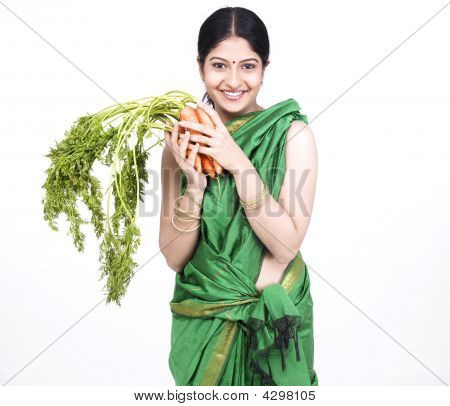 Asian Woman With A Bunch Of Carrots
