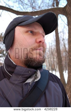 Portarait Of Young Man. Winter. Outdoors.