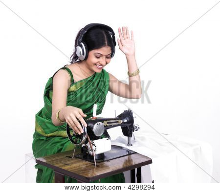 Asian Female Tailor With Headphones