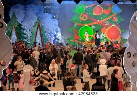 MOSCOW - JAN 04: audience listen to speeches by clowns MC on a stage at Forum Hall New Year masquerade of the Moscow families on Jan 04, 2012, Moscow, Russia.
