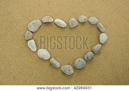 Heart Of Basalt Pebbles On Golden Beach