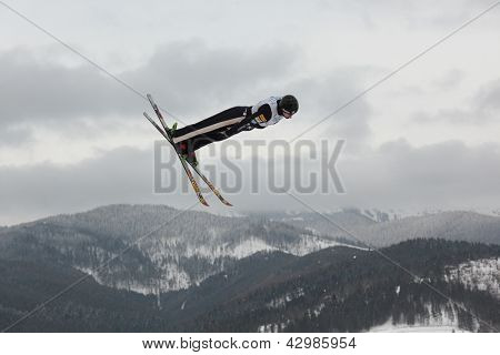BUKOVEL, UKRAINE - FEBRUARY 23: Dylan Ferguson, USA performs aerial skiing during Freestyle Ski World Cup in Bukovel, Ukraine on February 23, 2013