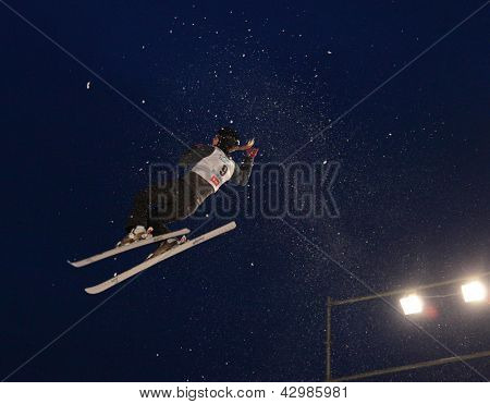 BUKOVEL, UKRAINE - FEBRUARY 23: Nadiya Didenko, Ukraine performs aerial skiing during Freestyle Ski World Cup in Bukovel, Ukraine on February 23, 2013