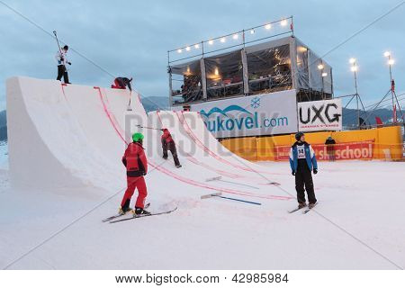 BUKOVEL, UKRAINE - FEBRUARY 23: Staff prepare the ramp during Freestyle Ski World Cup in Bukovel, Ukraine on February 23, 2013