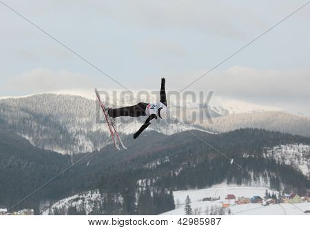 BUKOVEL, UKRAINE - FEBRUARY 23: Naoya Tabara, Japan performs aerial skiing during Freestyle Ski World Cup in Bukovel, Ukraine on February 23, 2013