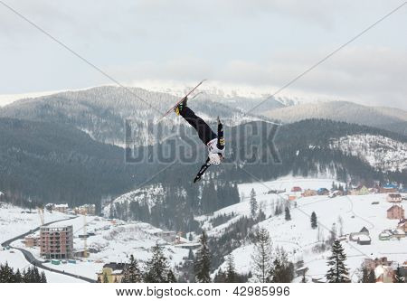 BUKOVEL, UKRAINE - FEBRUARY 23: Jonathon Lillis, USA performs aerial skiing during Freestyle Ski World Cup in Bukovel, Ukraine on February 23, 2013