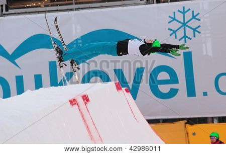 BUKOVEL, UKRAINE - FEBRUARY 23: Lloyd Wallace, Great Britain performs aerial skiing during Freestyle Ski World Cup in Bukovel, Ukraine on February 23, 2013