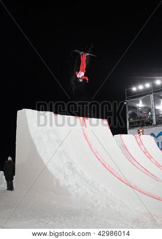 BUKOVEL, UKRAINE - FEBRUARY 23: Thomas Lambert, Switzerland performs aerial skiing during Freestyle Ski World Cup in Bukovel, Ukraine on February 23, 2013
